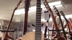 Tilt down acoustic guitar Stock Footage