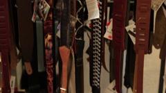 Tilt up multiple guitar straps Stock Footage