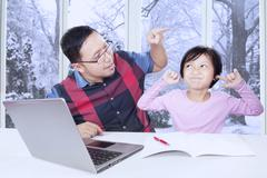 Dad advising his daughter to study Stock Photos