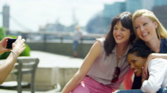 4K Happy attractive female friends posing for a photo outdoors in the city - stock footage