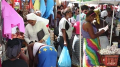 People in a market in cape Verde Africa Stock Footage