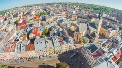 Wide aerial view over the city with walking people and tram traffic in Lviv, Stock Footage