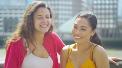 4K Portrait of smiling female friends in the city, blowing a kiss to camera Arkistovideo