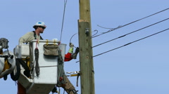 City Hydro Linemen Enjoying Their Work-Close Up Stock Footage