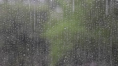 Stock Video Footage of Through Window With Raindrops Abstract