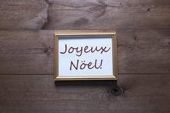 Golden Picture Frame With Joyeux Noel Merry Christmas Stock Photos