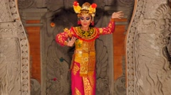 Female dancer performing traditional balinese dance Stock Footage