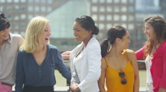 4K Portrait of smiling mixed ethnicity female friends outdoors in the city Stock Footage