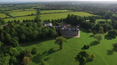 4K Aerial flight above country house & grounds in the English countryside - stock footage