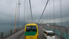 Cloudy morning ride along huge suspension bridge, fine perspective Stock Footage