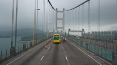 Drive along large Tsing Ma suspension bridge, cloudy mountains of Ma Wan ahead Stock Footage