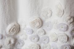 Textile wedding white background with pastel roses Stock Photos