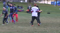 College and university students playing Quidditch on campus in the fall Stock Footage