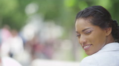 4K Portrait of beautiful woman smiling to camera outdoors in the city - stock footage