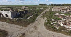 Aerial drone scene of abandoned destroyed house in the countryside at Epecuen Stock Footage