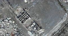 Top aerial view of destroyed town, transformed into rubble after disaster. Stock Footage