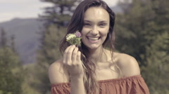 Beautiful Bohemian Model Holds Wild Flowers, She Smiles And Laughs (Slow Motion) Stock Footage