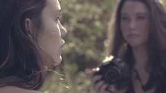 Beautiful Photographer Takes Photos Of Mixed Race Model In Nature (Slow Motion) Stock Footage