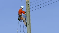 City Hydro Lineman Taking A Break On The Pole Stock Footage