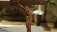 Little Crossed Jesus Figure On A Table - stock footage