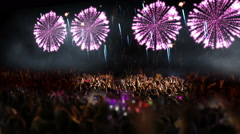 Crowd of people and fireworks explosions (camera pan) Stock Footage