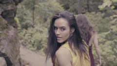 3 Models Walk In Forest, Model Looks Back Over Her Shoulder (Slow Motion) - stock footage