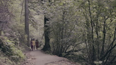 Models Walk Barefoot Toward Camera On Forest Path, Very Dreamlike (Slow Motion) Stock Footage