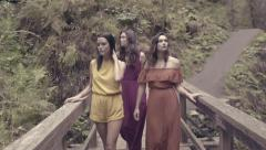 3 Beautiful Mixed Race Models Walk Across Bridge In Oregon Forest (Slow Motion) Stock Footage