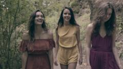 Mixed Race Models Walk Through Forest, They Laugh And Then Pose (Slow Motion) Stock Footage