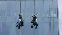 Stock Video Footage of Four window cleaners at work