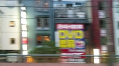 Train speeds through densely populated Tokyo Japan - stock footage