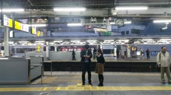 Couple on platform as Train departs - stock footage