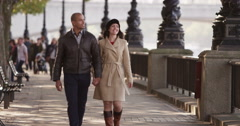 A happy attractive young professional couple spending time together in a city. - stock footage