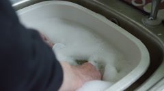 4K Hands of elderly man doing washing up at home. Stock Footage