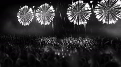 Crowd of people and fireworks explosions (camera pan colorless) Stock Footage