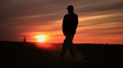 Guy dances modern dance at sunset Stock Footage