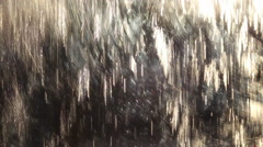 Abstract water flowing over stainless steel Stock Footage