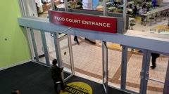 Top shot of food court entrance inside Coquitlam Center shopping mall Stock Footage