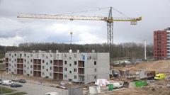 Crane lift white bag. Builders work on last floor. 4K Stock Footage
