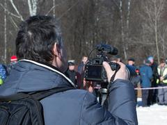 Man shooting a reportage Stock Photos