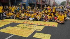 Demonstrators sit on street with banners,Kuala Lumpur,Malaysia Stock Footage