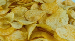 Potato chips are rotated in front of camera Stock Footage