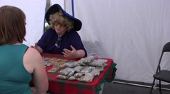Astrologer woman predict future for clients in divination festival. 4K Stock Footage