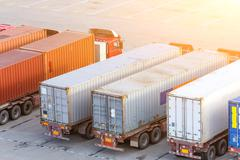 Transportation of cargoes in containers by lorry Stock Photos