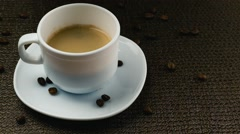 Pouring cream into a cup of coffee Stock Footage