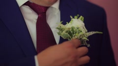 The groom corrects a buttonhole.mp4 Stock Footage