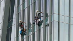 Two window cleaners at work Stock Footage
