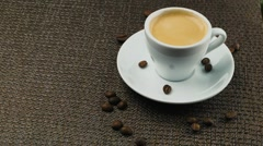 A cup of espresso, a handful of coffee beans Stock Footage