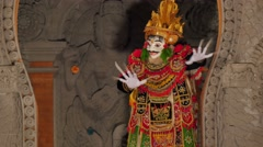 Masked balinese dancer performing dancing on stage Stock Footage