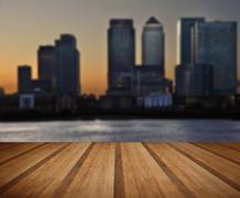 London City general skyline at night with wooden planks floor - stock photo